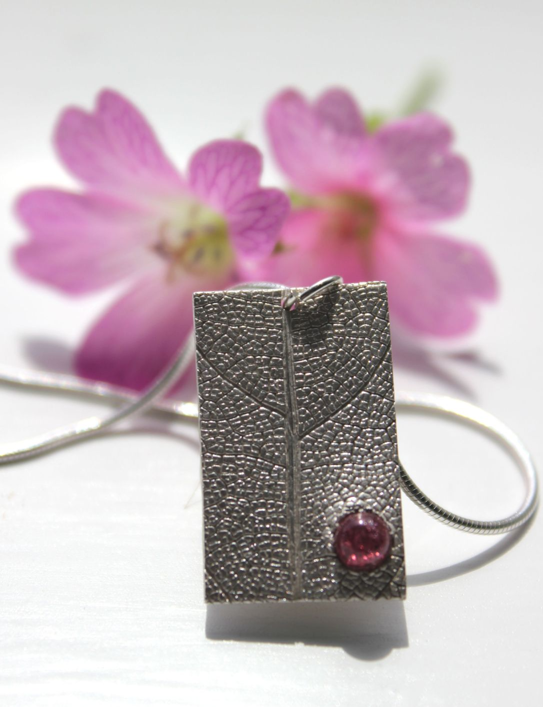 leaf-and-garnet-pendant-rectangle-by-little-silver-hedgehog