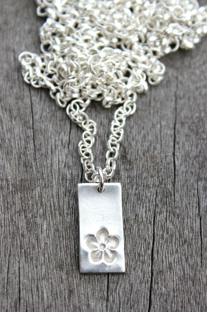 Silver flower pendant by little silver hedgehog.JPG