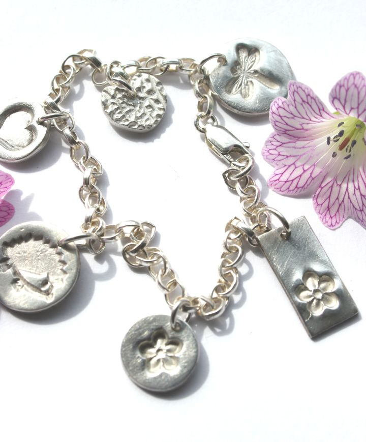Bespoke silver charm bracelet by little silver hedgehog