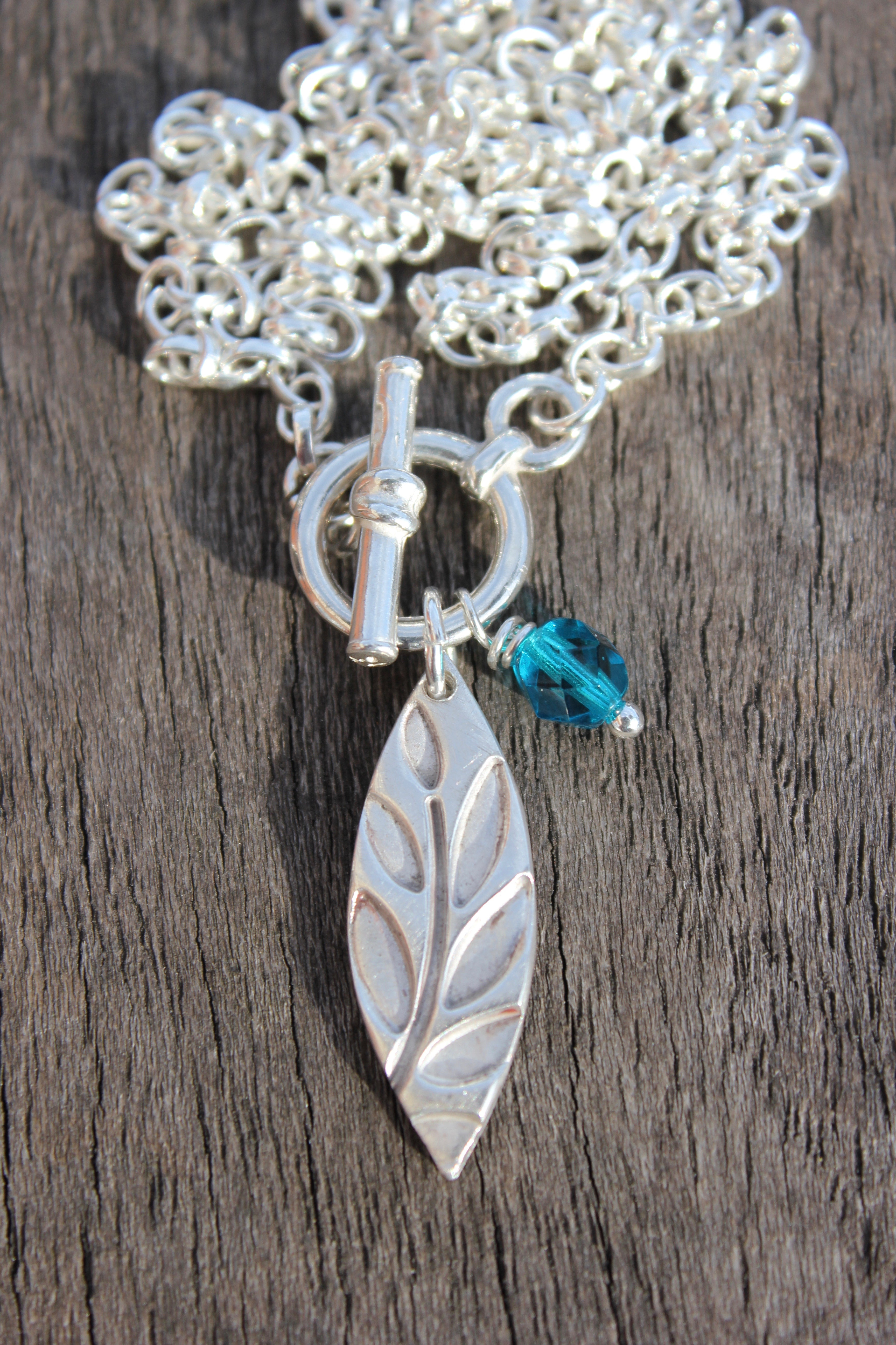 Front fastening contemporary silver leaf pendant