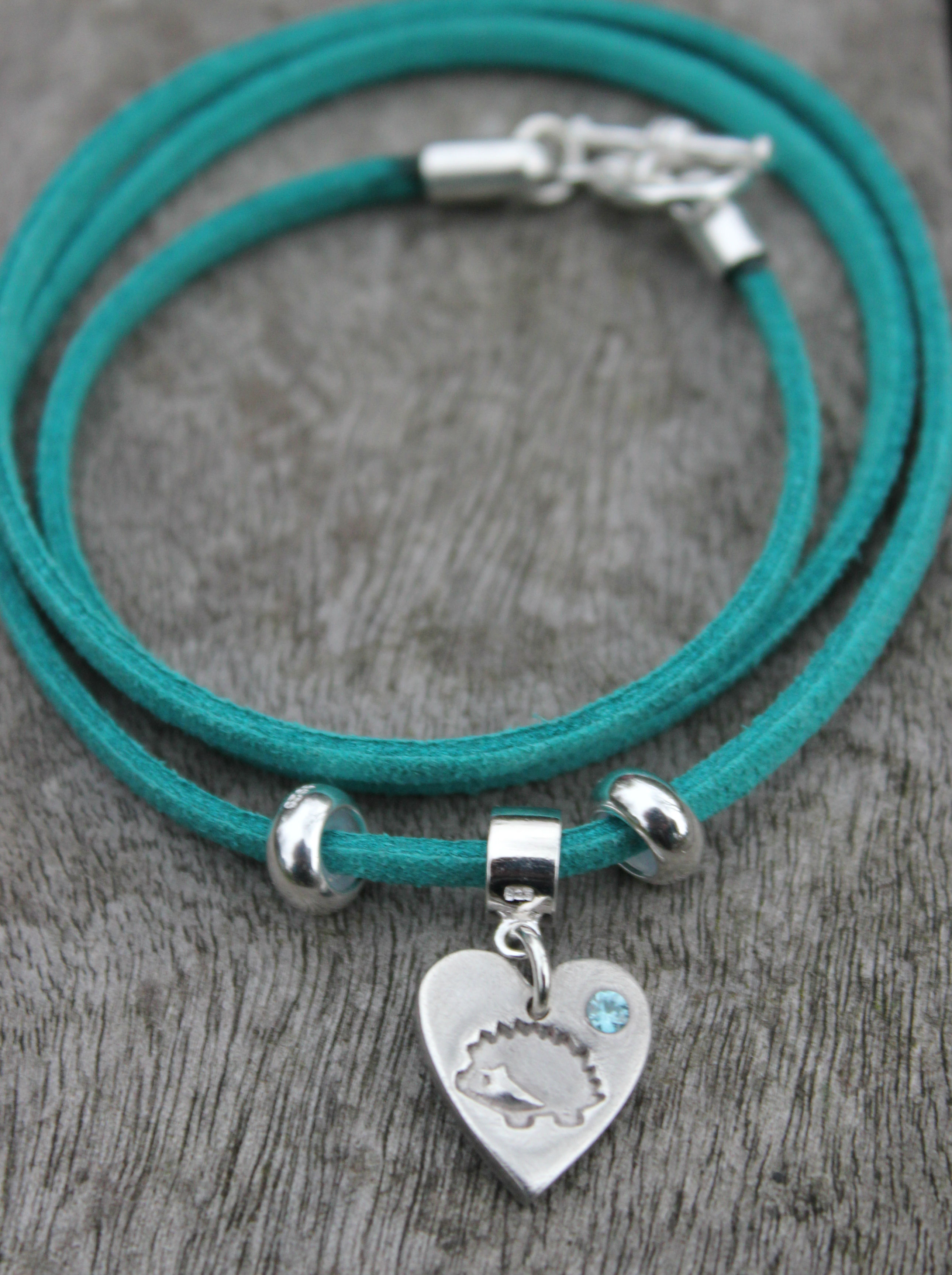 teal hedgehog bracelet with hedgehog charm with blue zircon