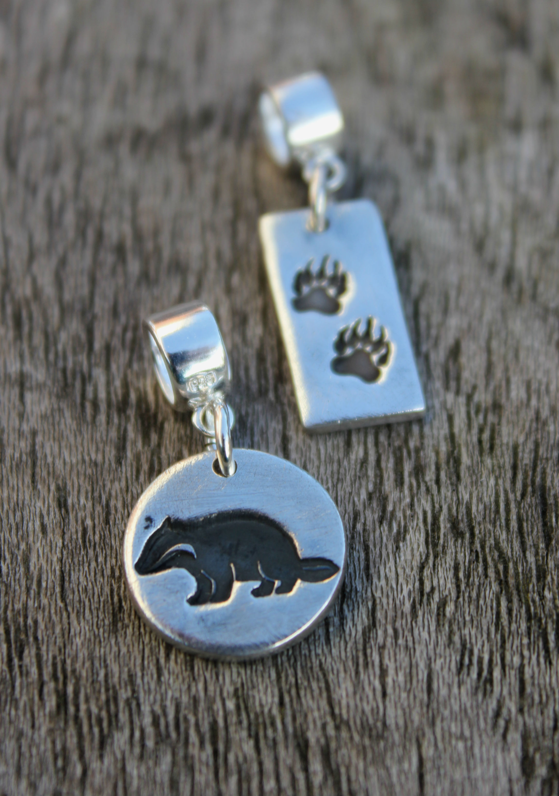 Badger charm and badger tracks charm.JPG
