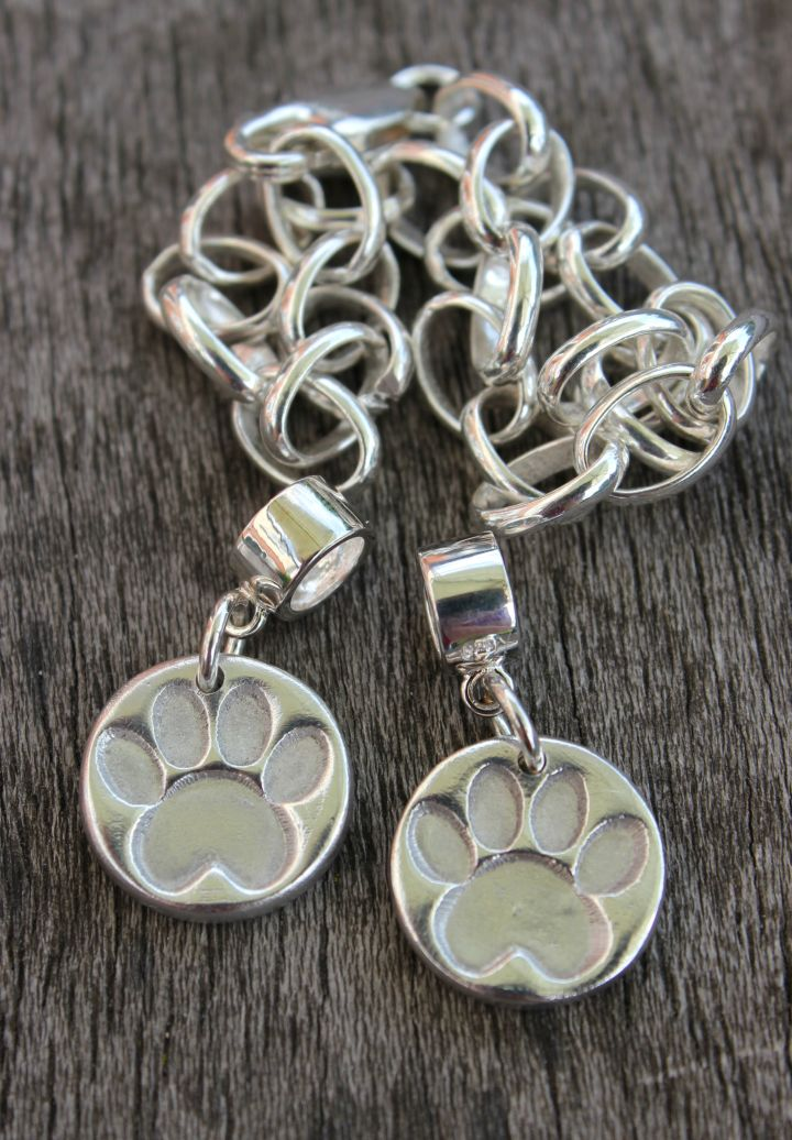 Silver pawprint Pandora charms, silver paw charm, dog paw charm, cat paw charm, handmade silver charms by Little Silver Hedgehog.JPG