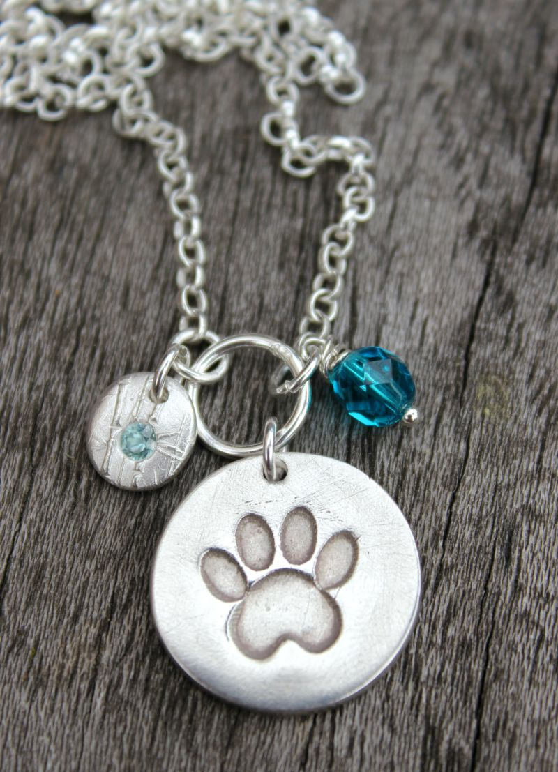 Silver paw print pendant by Little Silver Hedgehog