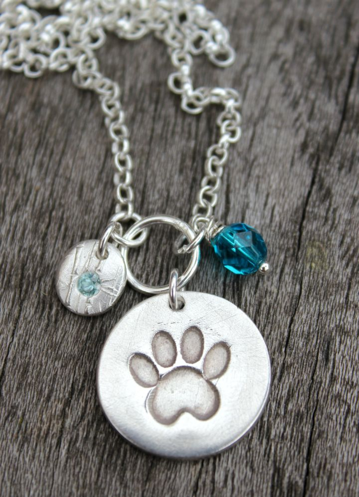 Paw print pendant with blue zircon pebble.JPG
