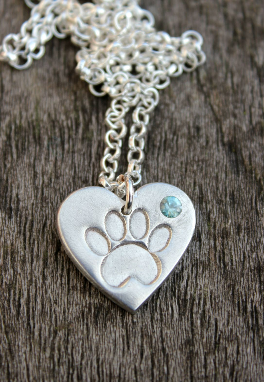 Pawprint heart with inset blue zircon.JPG