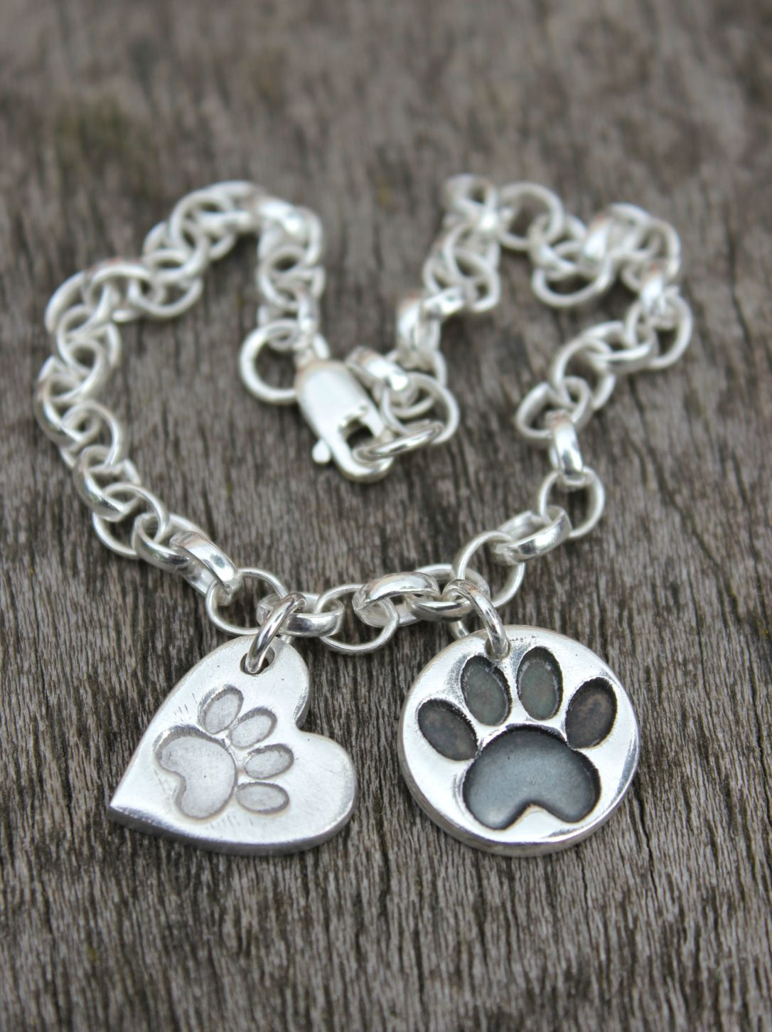 Solid silver pawprint charms by Little Silver Hedgehog