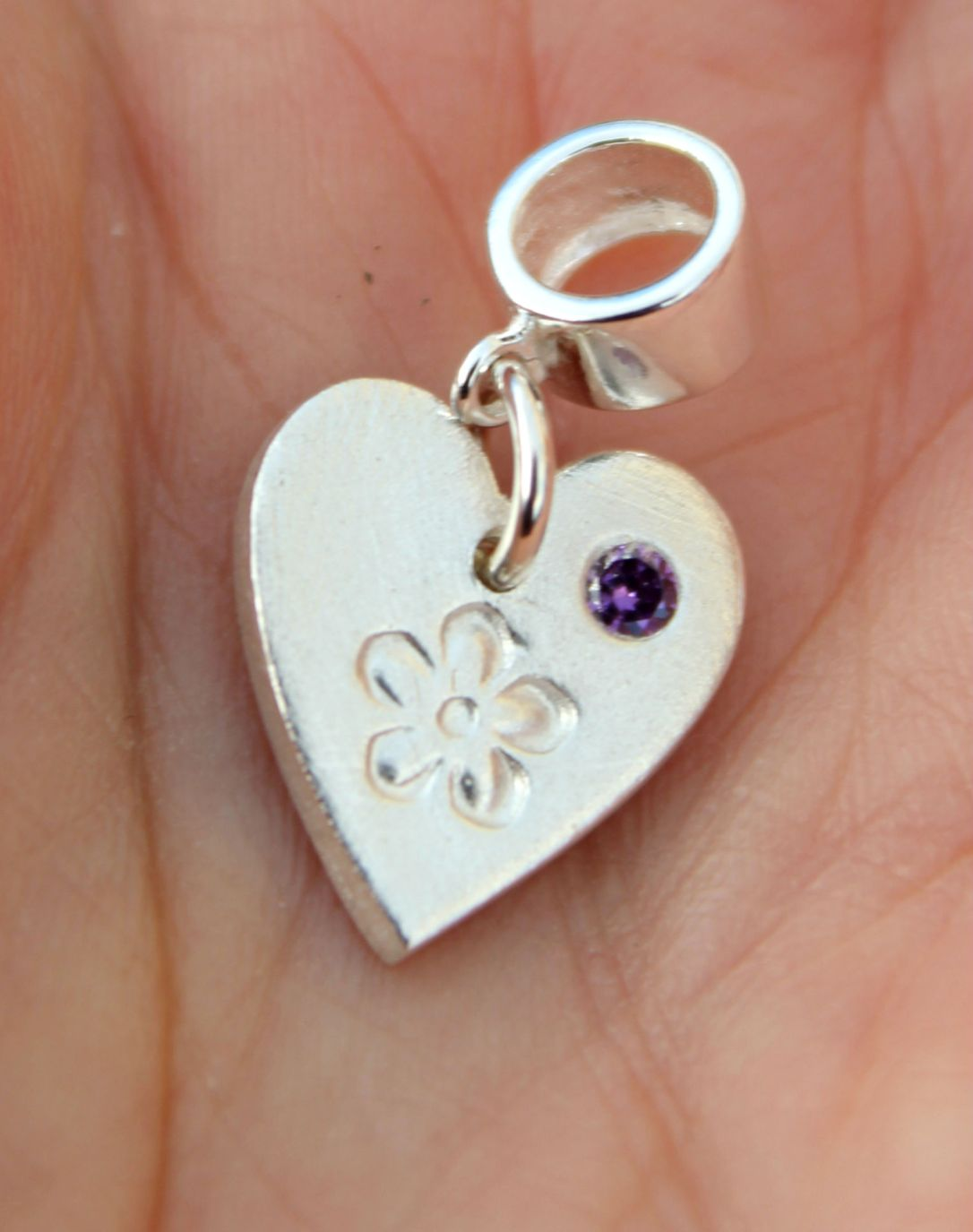 Tiny Pandora heart charm with flower and inset amethyst zirconia by Little Silver Hedgehog