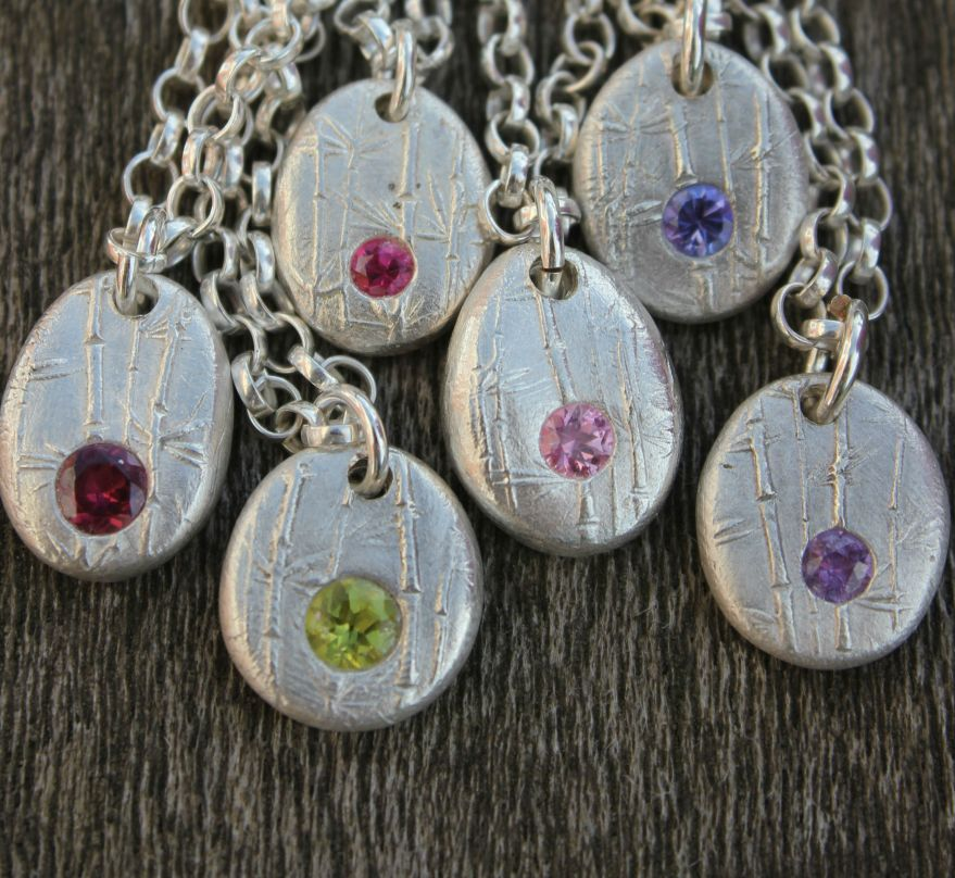 Silver pebble pendants by little silver hedgehog