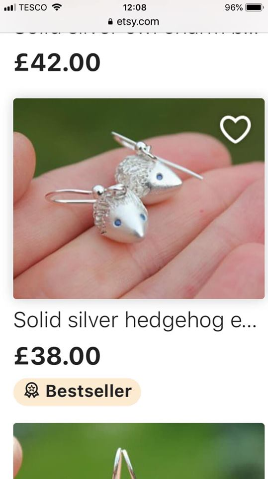 Solid silver hedgehog earrings with gemstone eyes