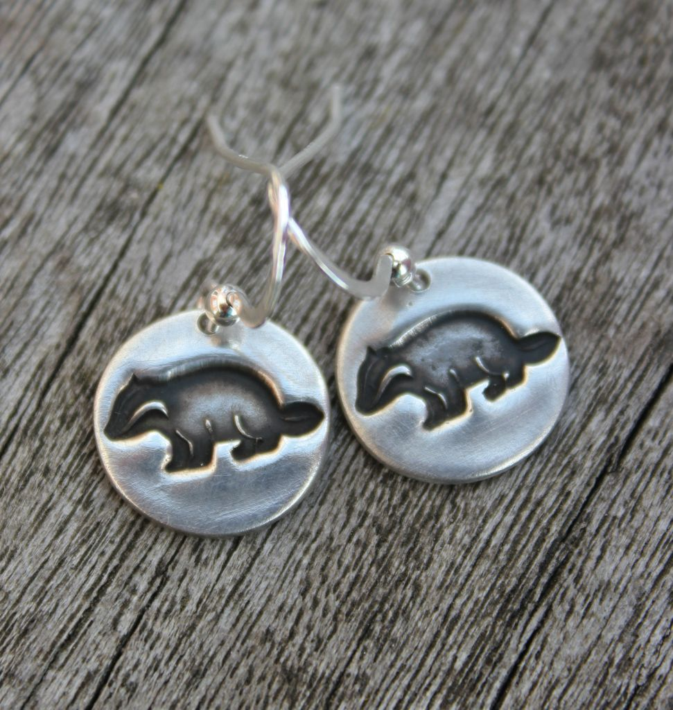 Silver badger earrings