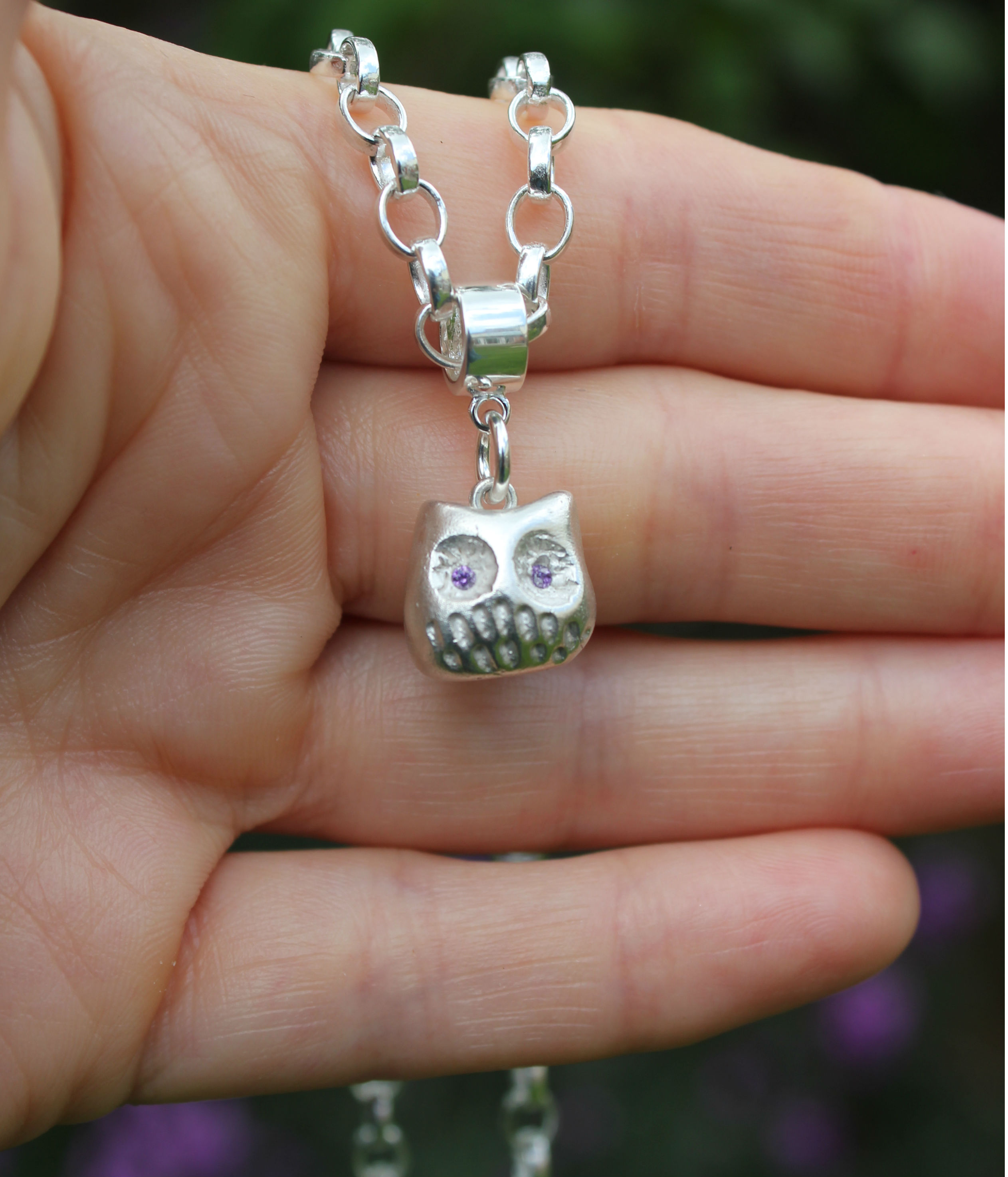 sculpted owl charm in hand